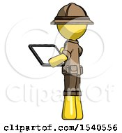 Yellow Explorer Ranger Man Looking At Tablet Device Computer With Back To Viewer