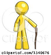 Yellow Design Mascot Man Standing With Hiking Stick