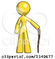 Yellow Design Mascot Woman Standing With Hiking Stick