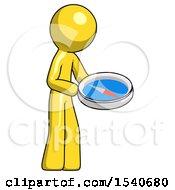 Yellow Design Mascot Man Looking At Large Compass Facing Right