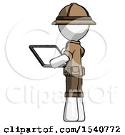 White Explorer Ranger Man Looking At Tablet Device Computer With Back To Viewer