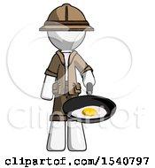 White Explorer Ranger Man Frying Egg In Pan Or Wok