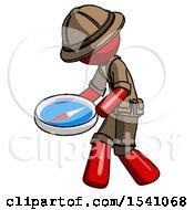 Red Explorer Ranger Man Walking With Large Compass