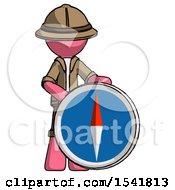 Pink Explorer Ranger Man Standing Beside Large Compass