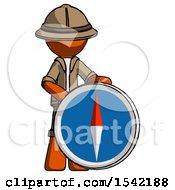 Orange Explorer Ranger Man Standing Beside Large Compass
