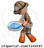 Orange Explorer Ranger Man Walking With Large Compass