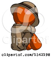 Orange Explorer Ranger Man Sitting With Head Down Back View Facing Right