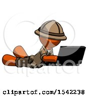 Orange Explorer Ranger Man Using Laptop Computer While Lying On Floor Side Angled View