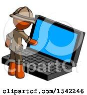 Orange Explorer Ranger Man Using Large Laptop Computer