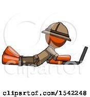 Orange Explorer Ranger Man Using Laptop Computer While Lying On Floor Side View