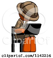 Orange Explorer Ranger Man Using Laptop Computer While Sitting In Chair Angled Right