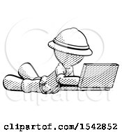 Halftone Explorer Ranger Man Using Laptop Computer While Lying On Floor Side Angled View
