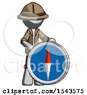 Gray Explorer Ranger Man Standing Beside Large Compass