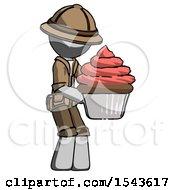 Gray Explorer Ranger Man Holding Large Cupcake Ready To Eat Or Serve