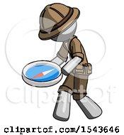 Gray Explorer Ranger Man Walking With Large Compass