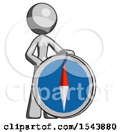 Gray Design Mascot Woman Standing Beside Large Compass