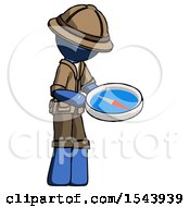 Blue Explorer Ranger Man Looking At Large Compass Facing Right