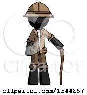Black Explorer Ranger Man Standing With Hiking Stick