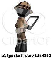 Black Explorer Ranger Man Looking At Tablet Device Computer Facing Away