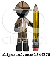 Black Explorer Ranger Man With Large Pencil Standing Ready To Write