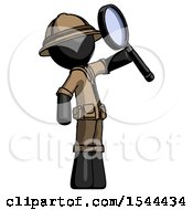 Black Explorer Ranger Man Inspecting With Large Magnifying Glass Facing Up