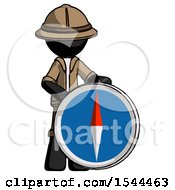 Black Explorer Ranger Man Standing Beside Large Compass