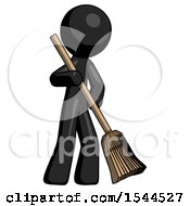 Black Design Mascot Man Sweeping Area With Broom