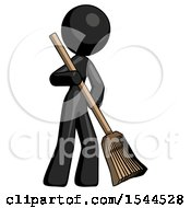 Black Design Mascot Woman Sweeping Area With Broom