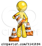 Yellow Design Mascot Man Holding A Traffic Cone