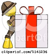 Yellow Explorer Ranger Man Gift Concept Leaning Against Large Present