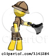 Yellow Explorer Ranger Man Dusting With Feather Duster Downwards
