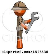 Orange Explorer Ranger Man Using Wrench Adjusting Something To Right