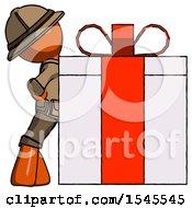 Orange Explorer Ranger Man Gift Concept Leaning Against Large Present