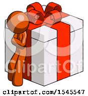 Orange Design Mascot Man Leaning On Gift With Red Bow Angle View