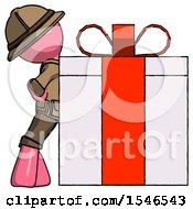 Pink Explorer Ranger Man Gift Concept Leaning Against Large Present