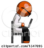 Orange Doctor Scientist Man Using Laptop Computer While Sitting In Chair View From Side