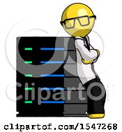 Yellow Doctor Scientist Man Resting Against Server Rack Viewed At Angle