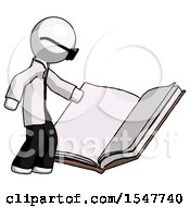 Poster, Art Print Of White Doctor Scientist Man Reading Big Book While Standing Beside It