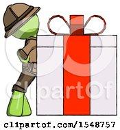 Green Explorer Ranger Man Gift Concept Leaning Against Large Present