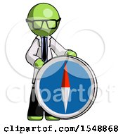 Green Doctor Scientist Man Standing Beside Large Compass