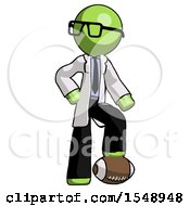 Green Doctor Scientist Man Standing With Foot On Football