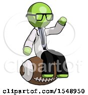 Green Doctor Scientist Man Sitting On Giant Football