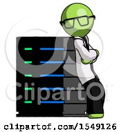 Green Doctor Scientist Man Resting Against Server Rack Viewed At Angle