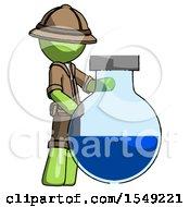 Green Explorer Ranger Man Standing Beside Large Round Flask Or Beaker