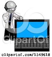 Gray Doctor Scientist Man Beside Large Laptop Computer Leaning Against It