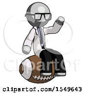 Gray Doctor Scientist Man Sitting On Giant Football