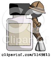Gray Explorer Ranger Man Leaning Against Large Medicine Bottle