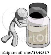 Gray Design Mascot Man Pushing Large Medicine Bottle