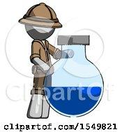 Gray Explorer Ranger Man Standing Beside Large Round Flask Or Beaker