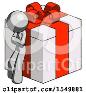 Gray Design Mascot Man Leaning On Gift With Red Bow Angle View